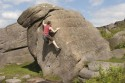 Jamie Vetch climbing The Shearing (V2 5c) at Burbage South.