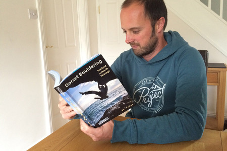 Author Ben Stokes with a copy of the new Dorset Bouldering guidebook.